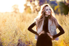 Young woman outdoors fashion portrait. Royalty Free Stock Images