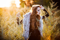 Young woman outdoors fashion portrait. Stock Photo