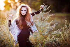 Young woman outdoors fashion portrait. Royalty Free Stock Photo