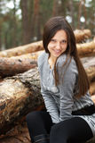 Young woman outdoors in forest Stock Images