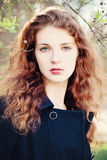 Young Woman Outdoors. Girl with Red Curly Hair Royalty Free Stock Photos