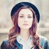 Young woman outdoors. Makeup. Windy Hair Stock Photography