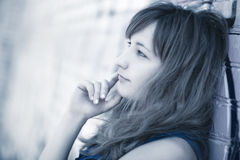 Young woman outdoors portrait. Soft blue tint Royalty Free Stock Photography