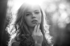 Young woman outdoors portrait. Black and white colors Royalty Free Stock Photography