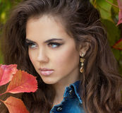 Young woman outdoors portrait. Beautiful face Stock Photography