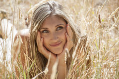 Young woman outdoors portrait. Soft sunny colors. Young woman outdoors portrait. Soft sunny colors in the woods Stock Photos