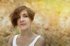 Young woman outdoors portrait. Soft sunny colors. In white shirt Royalty Free Stock Images