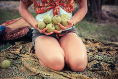 Young woman outside with apples Royalty Free Stock Photos