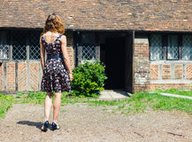 Young woman outside country house Royalty Free Stock Photos