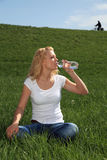 Young woman outside drinking water Royalty Free Stock Photography