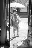 Young woman outside a restaurant. Black and white Stock Photography
