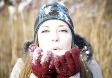 Young woman outside in the snow Royalty Free Stock Photo