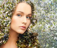 Young woman over blooming tree pattern. Beauty, people, spring, summer season and health concept - young woman over blooming tree floral pattern and double Royalty Free Stock Images
