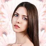 Young woman over flowers background. Stock Photography