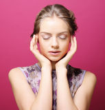 Young woman over pink background Royalty Free Stock Images