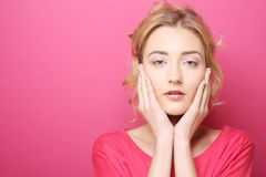Young woman over pink background. Portrait young woman over pink background Stock Photography