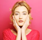 Young woman over pink background. Portrait young woman over pink background Royalty Free Stock Images