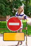 Young woman over the warning road signs Stock Images