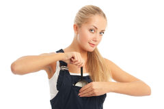 Young woman with overalls on Royalty Free Stock Photography