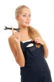 Young woman with overalls on Stock Images