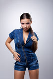 Young woman in overalls Stock Photos