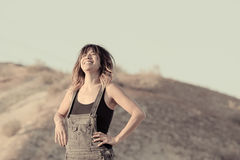 Young woman in overalls laughing Royalty Free Stock Image