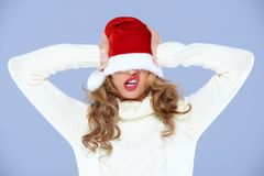 Young woman in an oversized Santa hat Stock Photos