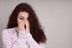 Young woman is overwhelmed with emotion Royalty Free Stock Image