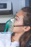 Young woman with oxygen mask Stock Image
