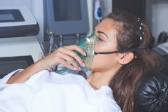 Young woman with oxygen mask Stock Photo