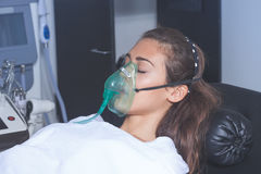 Young woman with oxygen mask Royalty Free Stock Image