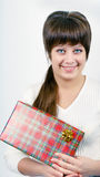 Young woman with packaged gift Royalty Free Stock Photo