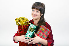 Young woman with packaged gifts Stock Photo