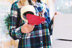 Young woman packing boxes to be shipped. In her home office stock photos