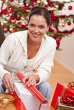 Young woman packing Christmas present Royalty Free Stock Photography