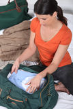 Young woman packing luggage Royalty Free Stock Photography