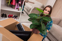The young woman packing personal belongings Stock Images