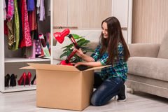 The young woman packing personal belongings Stock Image