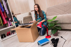 The young woman packing personal belongings Stock Photo