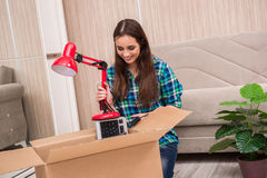 The young woman packing personal belongings Stock Photography