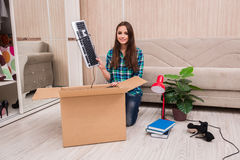 The young woman packing personal belongings Royalty Free Stock Image