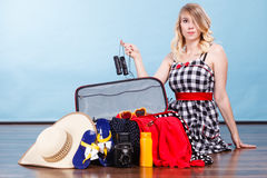Young woman packing suitcase Stock Photography