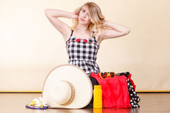 Young woman packing suitcase Royalty Free Stock Photography