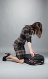 Young woman packing suitcase for travel Stock Photo