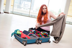 The young woman packing for travel vacation Stock Images