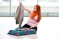 The young woman packing for travel vacation Stock Photography