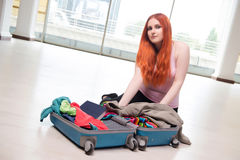 The young woman packing for travel vacation Royalty Free Stock Image