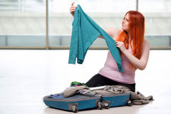 The young woman packing for travel vacation Royalty Free Stock Photos