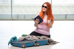 The young woman packing for travel vacation Royalty Free Stock Photo