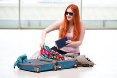 The young woman packing for travel vacation Stock Photo